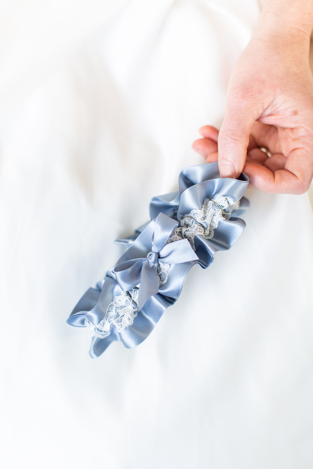 custom garter with dusty blue and ivory lace