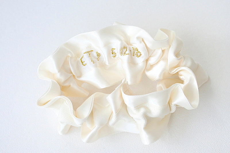 custom wedding garter with gold embroidery on inside