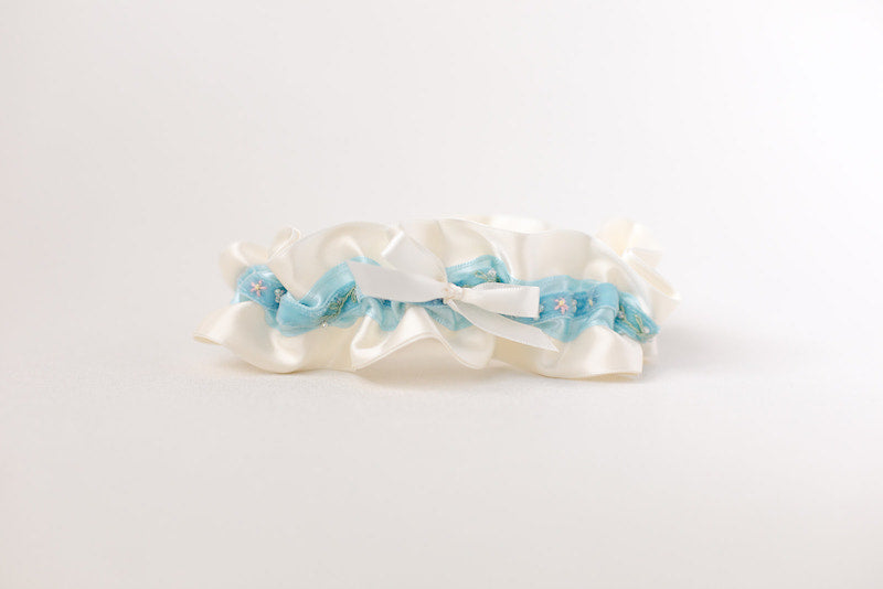 custom garter with blue velvet with flowers and sparkle