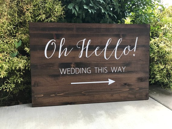 fun and festive wooden wedding welcome sign