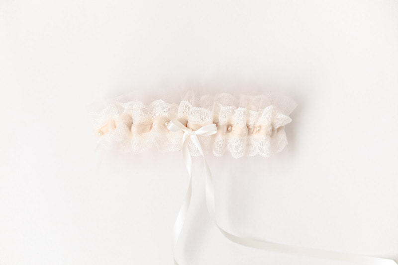 custom garter with blush tulle, velvet, pearls and hand embroidered on the inside by The Garter Girl