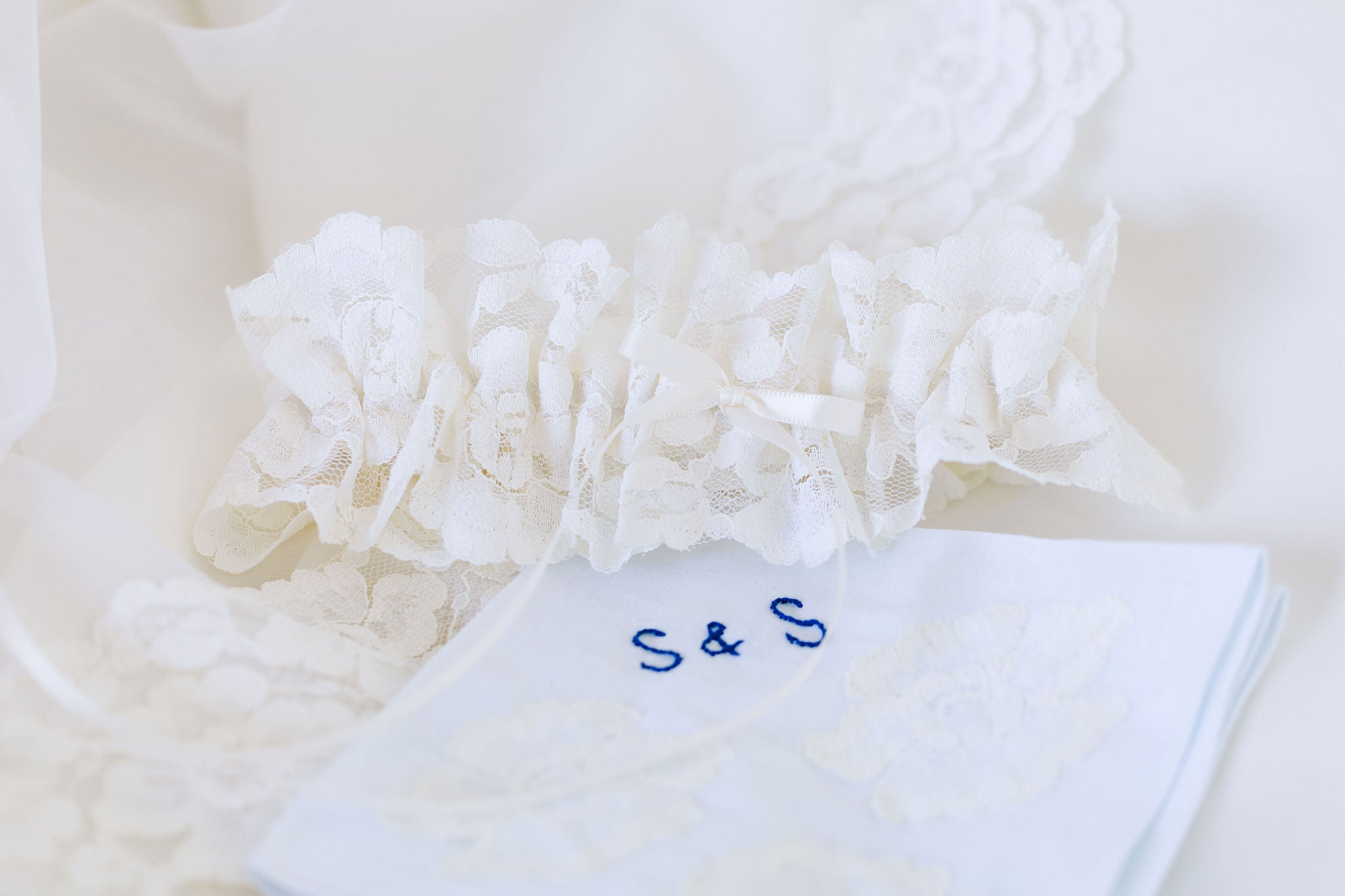 garter and handkerchief handmade from the bride's mother's wedding dress lace by The Garter Girl
