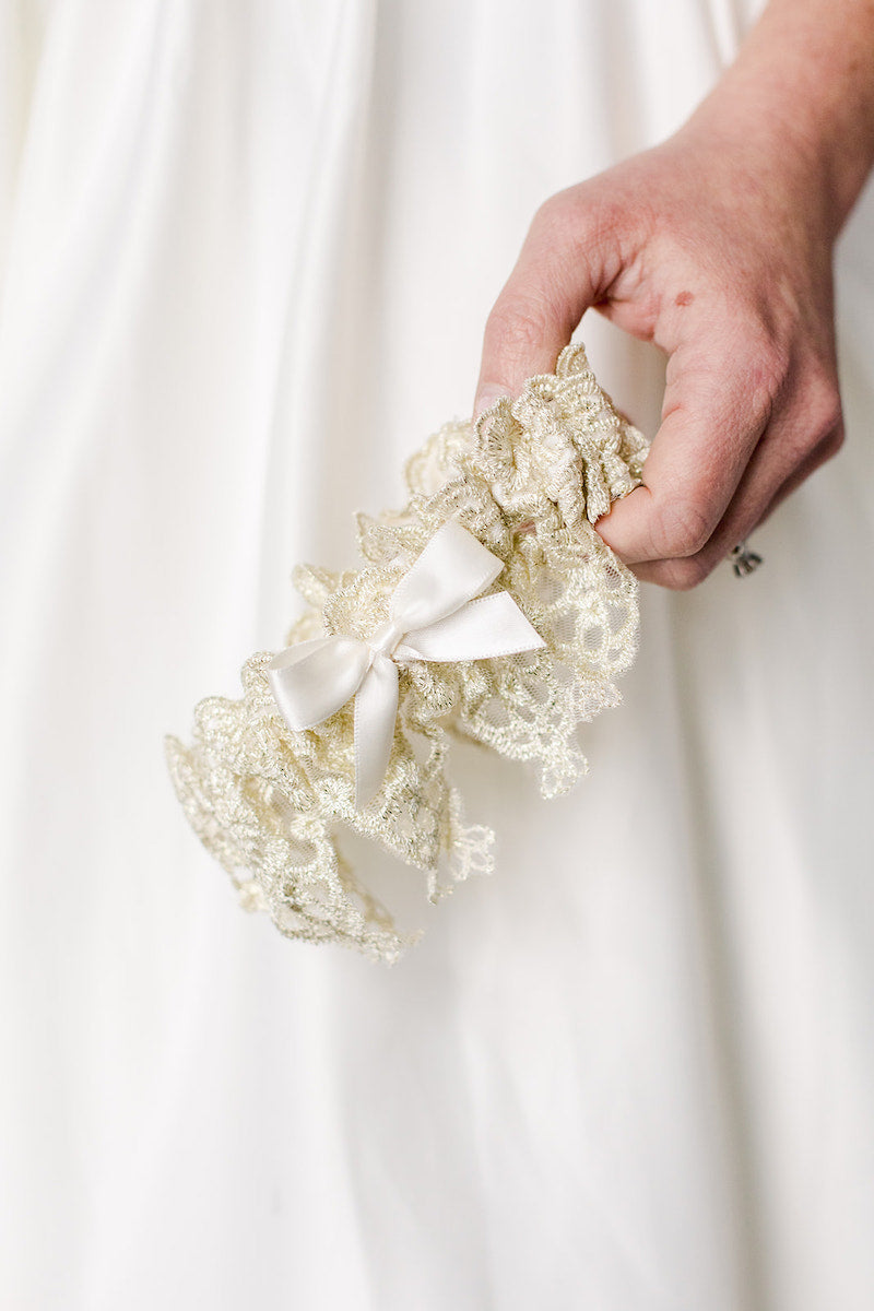 custom heirloom garter with gold lace and ivory satin
