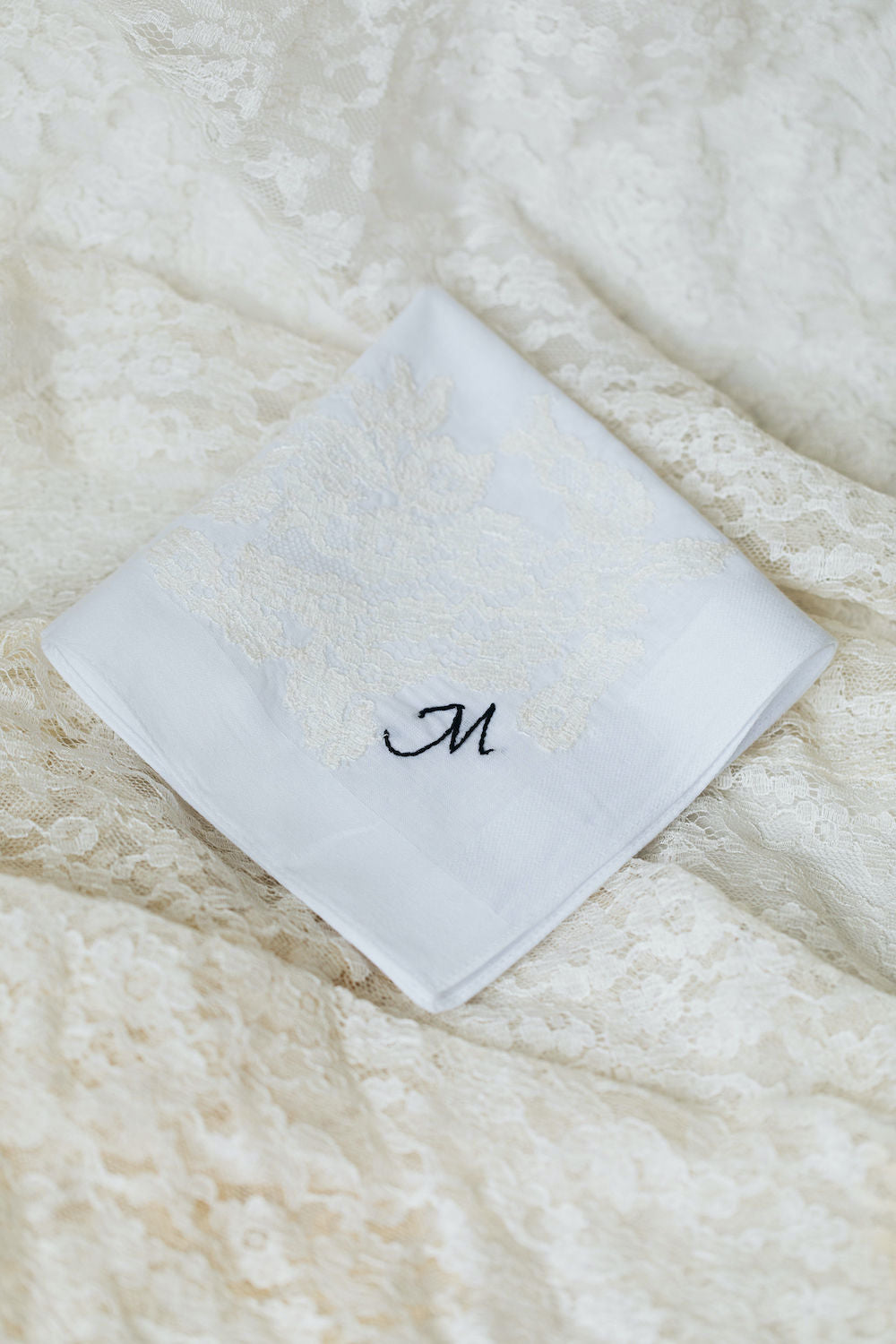 using great grandmother's wedding dress lace on two wedding handkerchiefs personalized with monogram embroidery - handmade wedding heirlooms from The Garter Girl