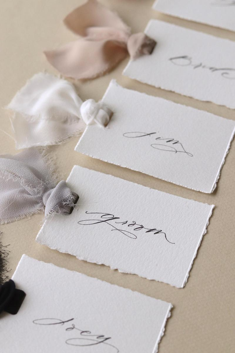 Handwritten White Paper Place Cards with Torn Edges