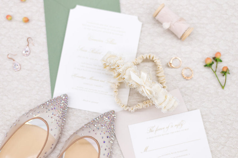 lace wedding garter and sage wedding invitations and sparkle bridal shoes