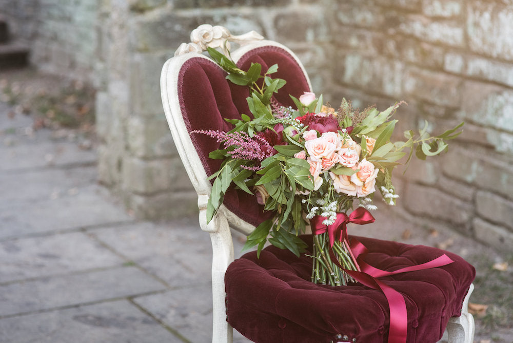 elegant bridal bouquet - tips for changing or postponing wedding date from The Garter Girl