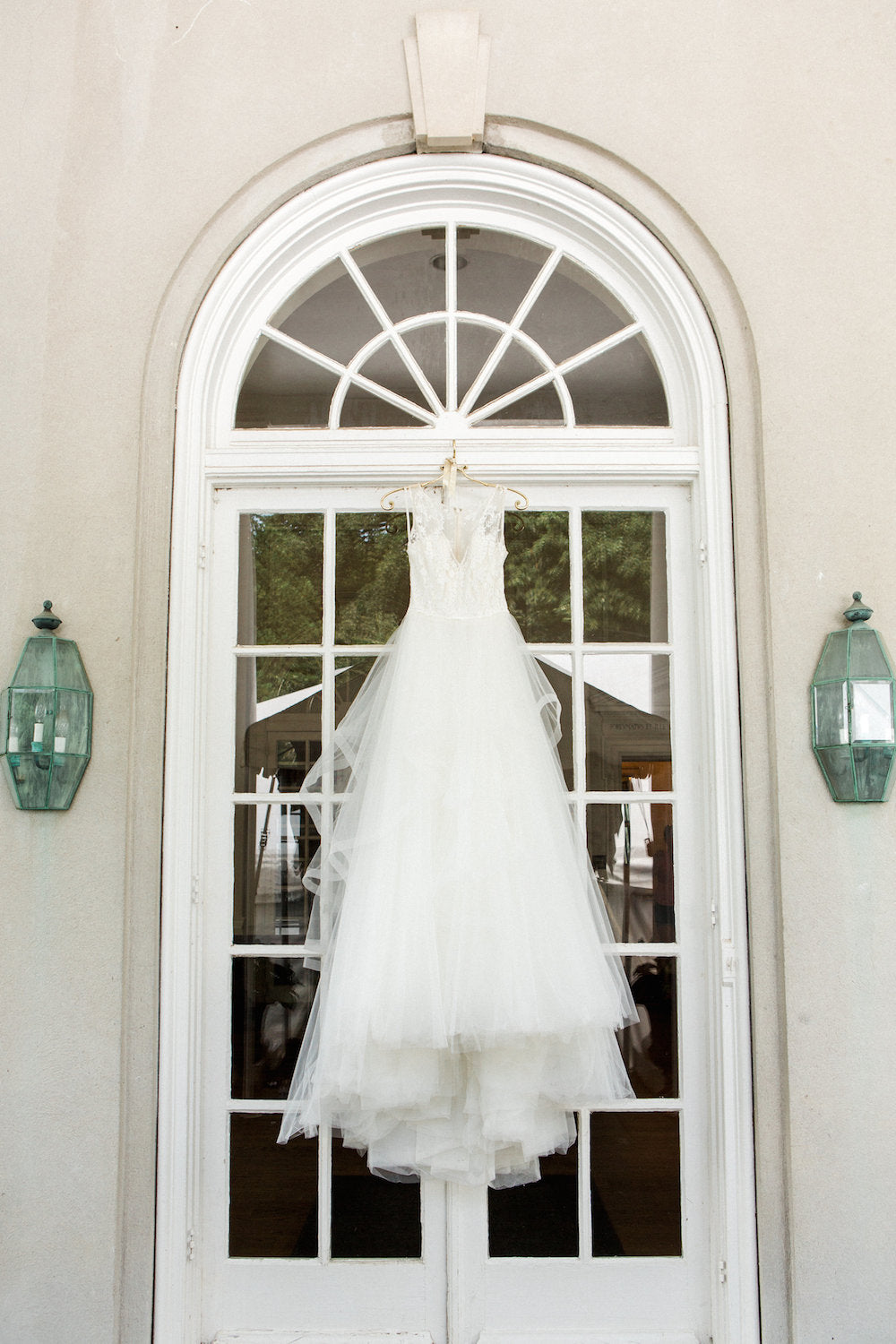 hanging wedding dress - tips about trying wedding dresses on at home from The Garter Girl