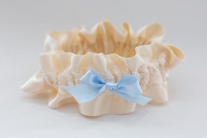 custom garter with ivory lace and blue bow