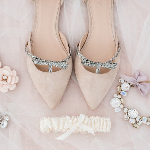lace wedding garter by The Garter Girl and blush bridal shoes