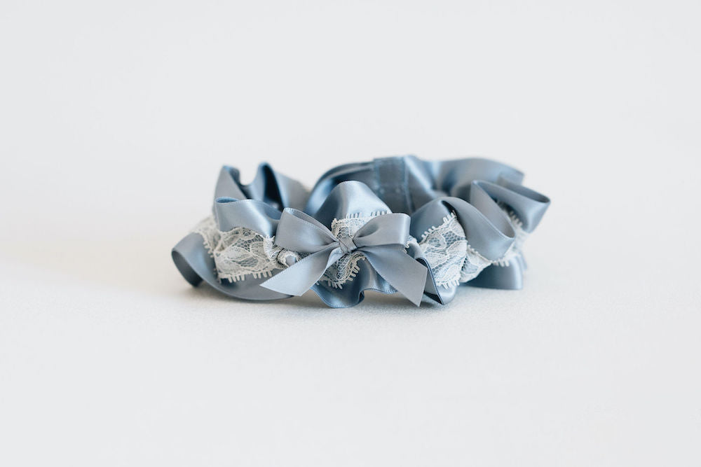custom wedding garter set handmade with dusty blue satin & ivory lace and personalized embroidery by expert bridal accessory designer, The Garter Girl