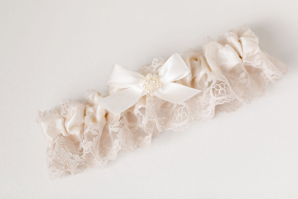 custom garter set with pearls and champagne lace