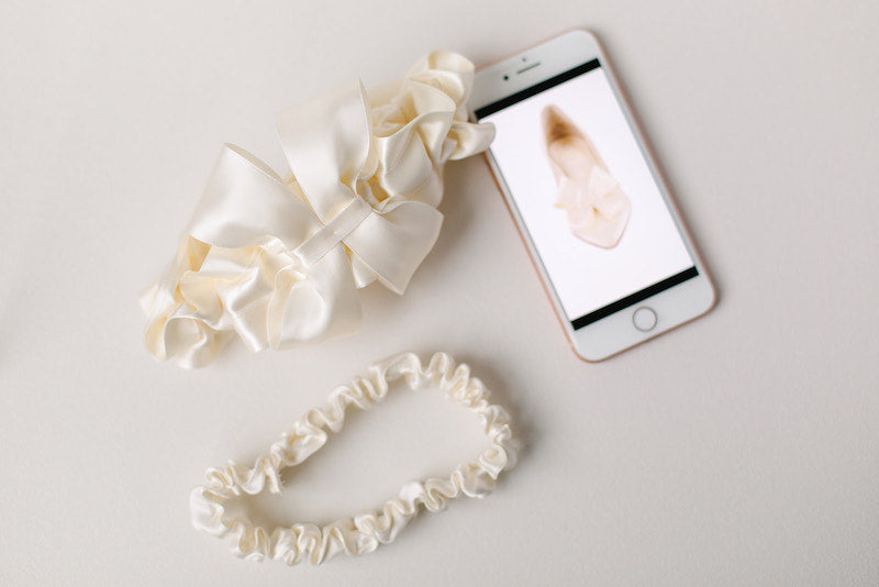 modern wedding garter with bow to match bride's shoes