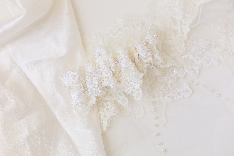 heirloom garter made from bride's mother's and grandmother's wedding dresses