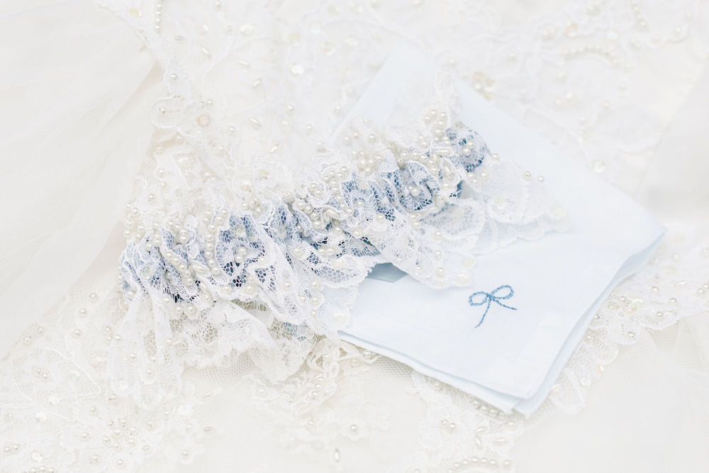 wedding garter heirloom handmade from the bride's mother's wedding dress hem with lace, pearls and dusty blue satin by The Garter Girl