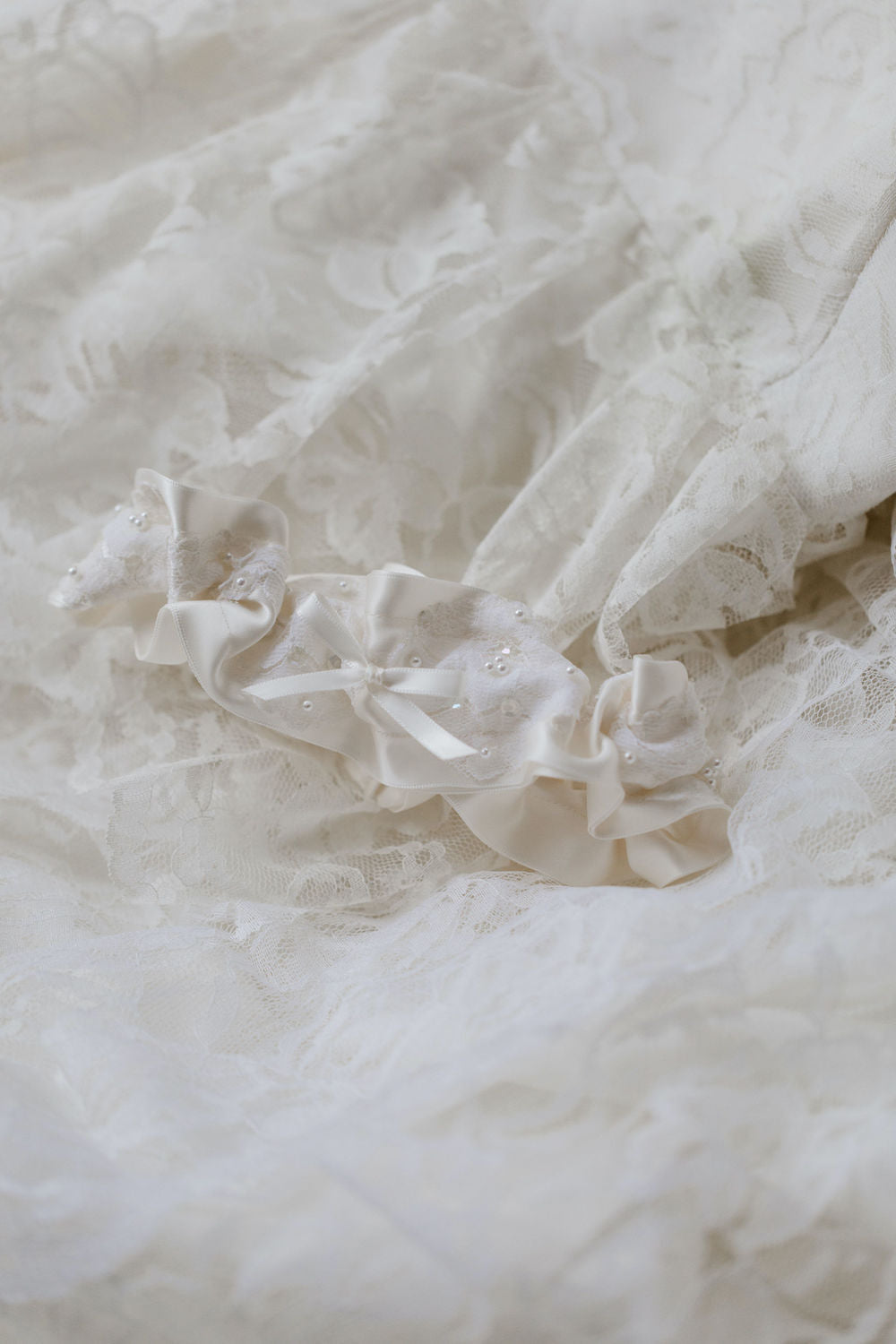 wedding garter handmade with lace and pearls from the collar of the mother's wedding dress by The Garter Girl