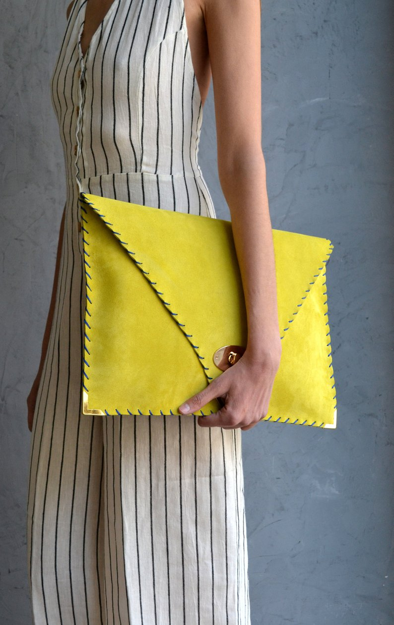 mustard yellow clutch wedding rehearsal dinner outfit accessory