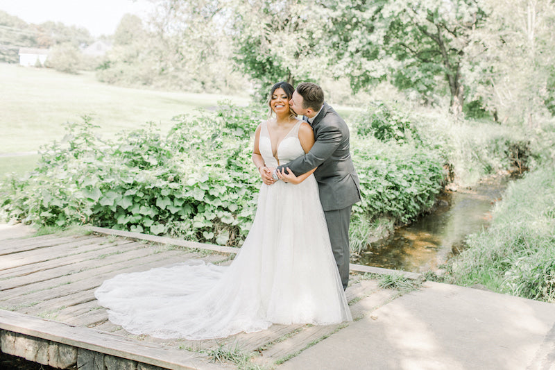 Outdoor Wedding Bride and Groom with Lush Greenery Willow Tree