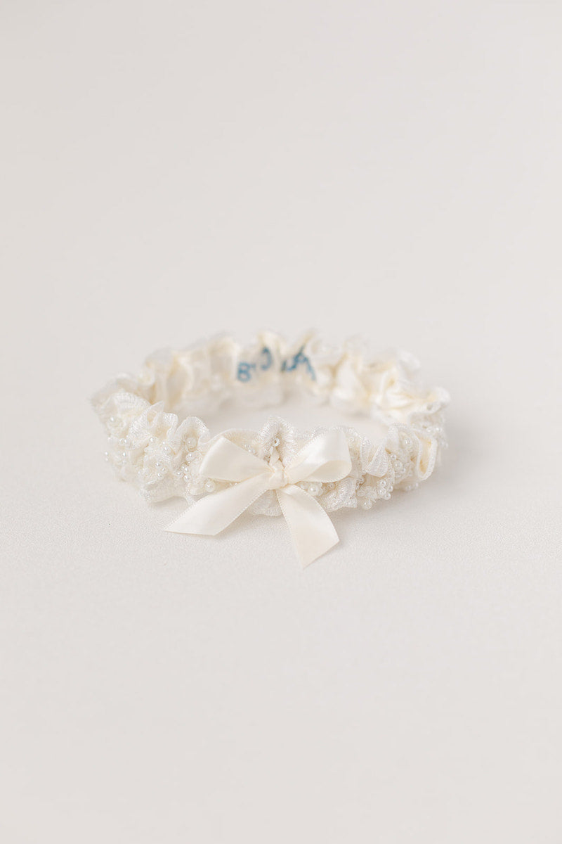 pearl and lace wedding garter with personalization