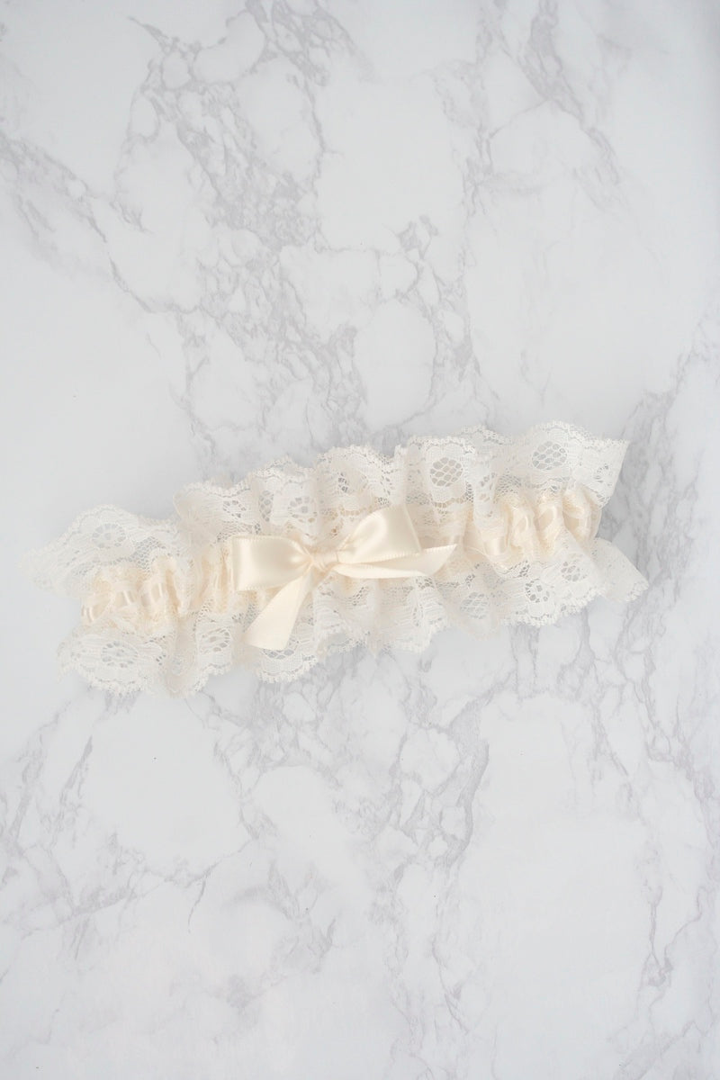 ivory lace wedding garter on marble