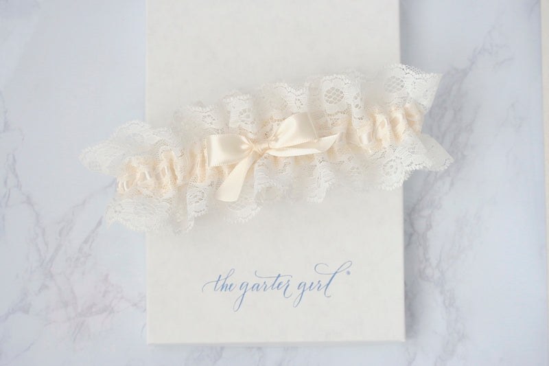 ivory lace wedding garter on gift box