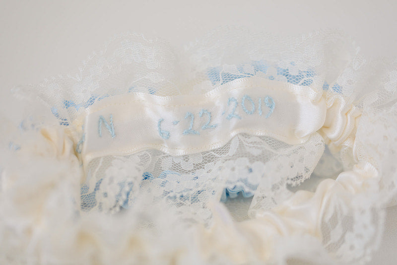 personalized wedding garter set with lace, blue and embroidery