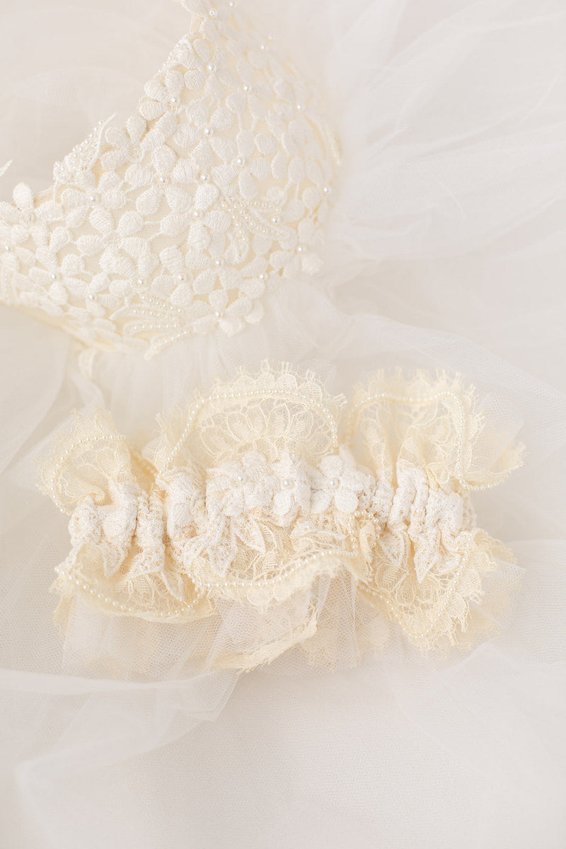 personalized garter made from mom's and aunt's wedding dress and veil