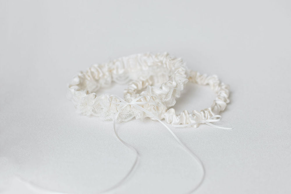 ivory lace ruffled wedding garter set personalized with hand embroidery by The Garter Girl