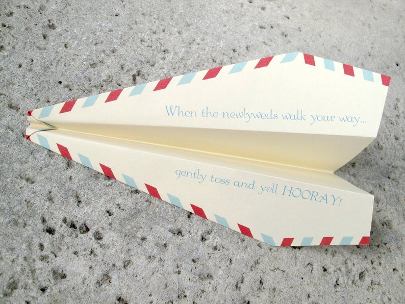 personalized paper planes wedding exit toss idea