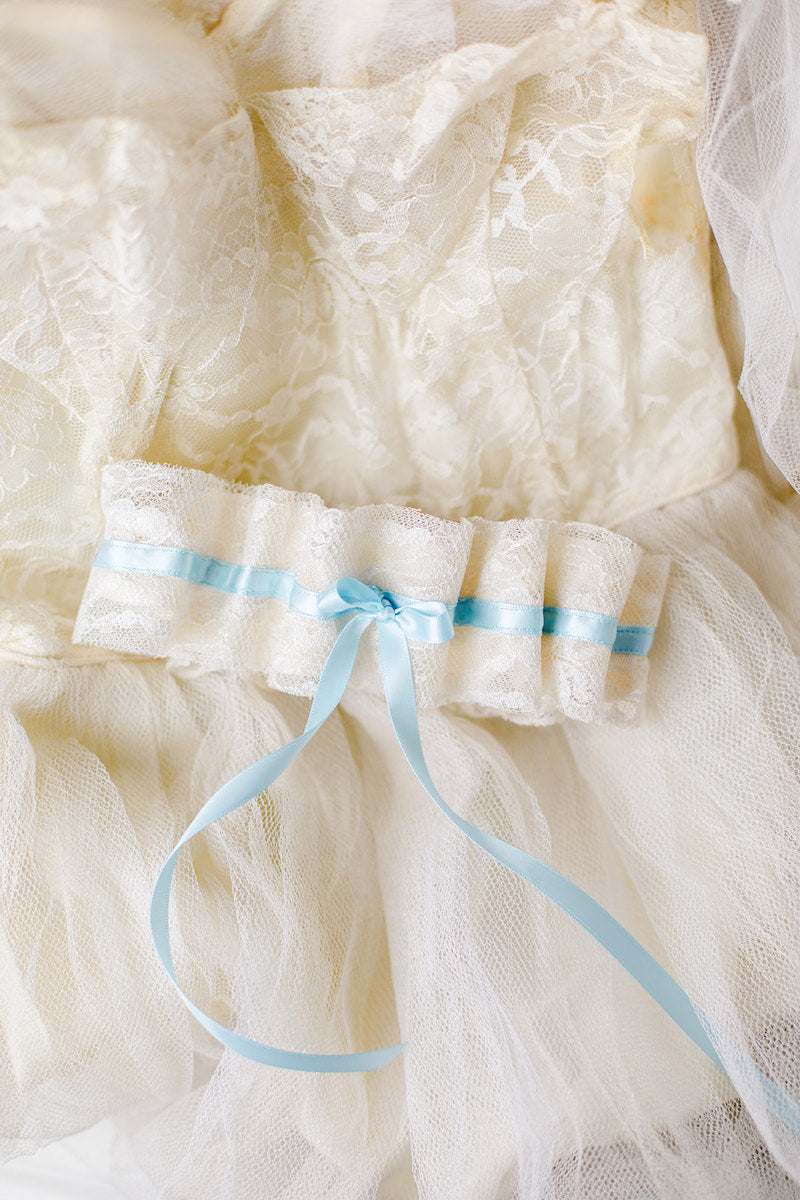personalized wedding garter made from bride's mother's wedding dress with tulle and lace and something blue