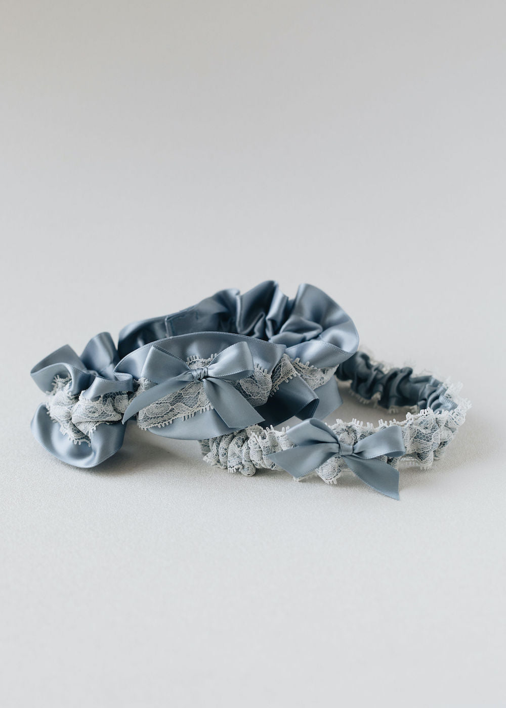 personalized handmade wedding garter set with dusty blue satin and ivory lace by expert bridal heirloom accessories designer, The Garter Girl