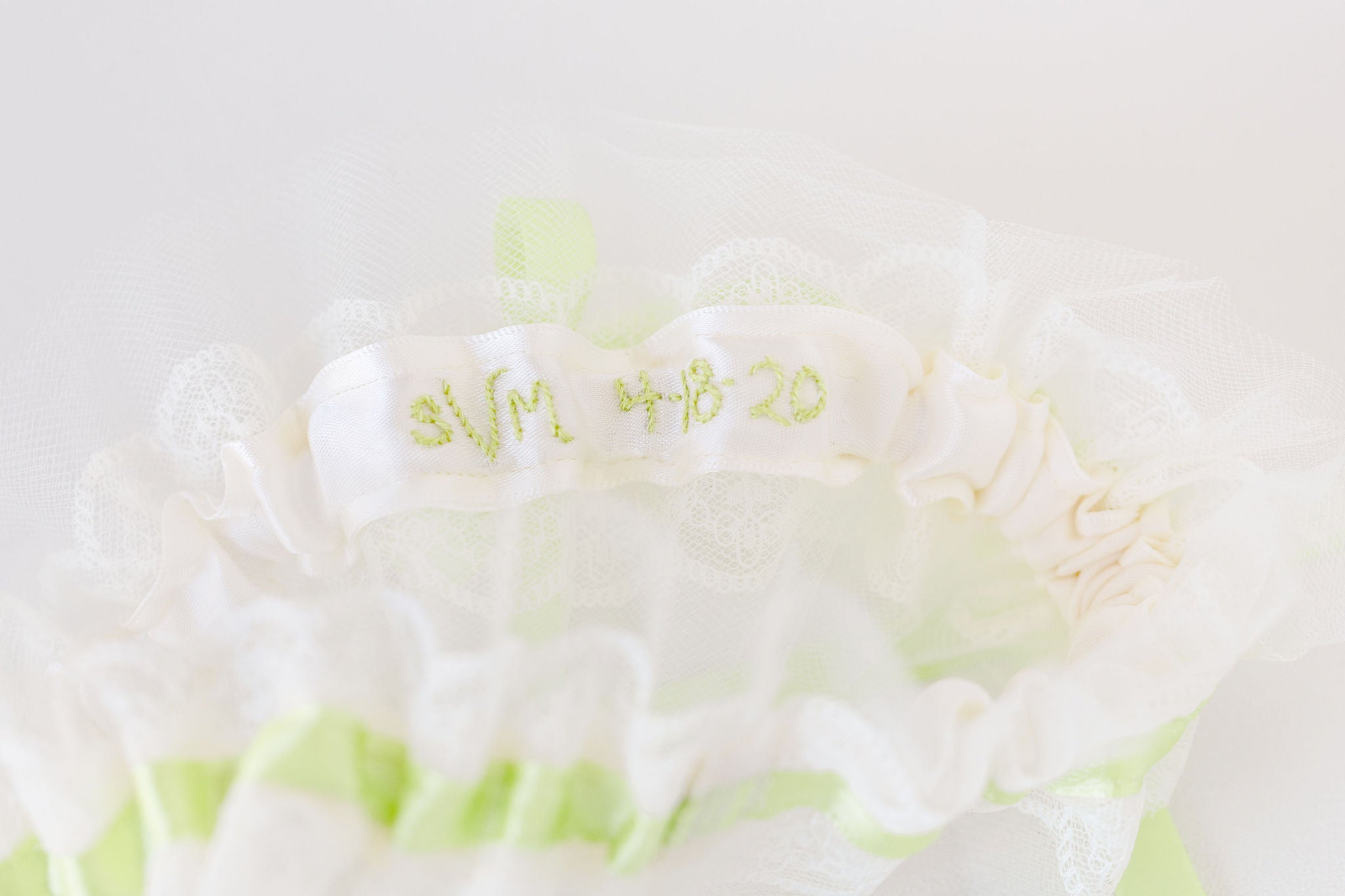 custom wedding garter with pistachio satin, ivory lace & tulle personalized by The Garter Girl