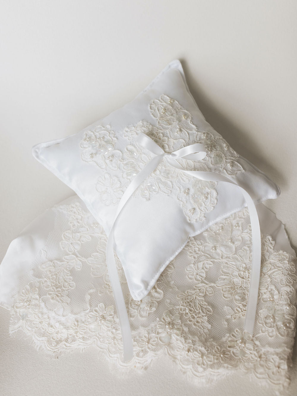 a wedding ring bearer pillow handmade with lace and pearls from the bride's mother's wedding dress by expert heirloom designer, The Garter Girl