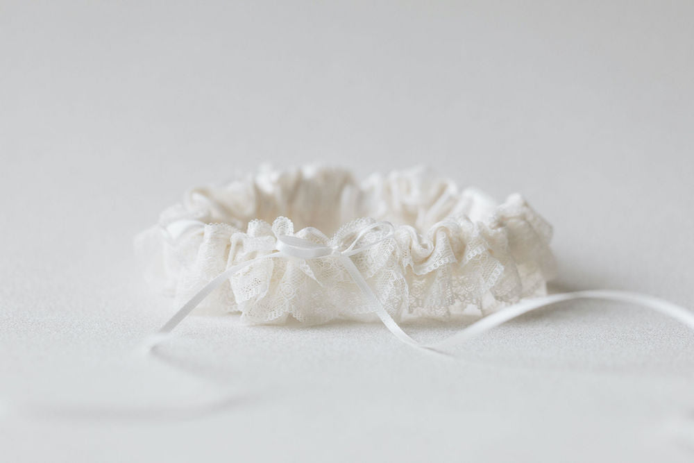 pretty ruffled ivory lace and satin personalized wedding garter handmade heirloom by The Garter Girl.