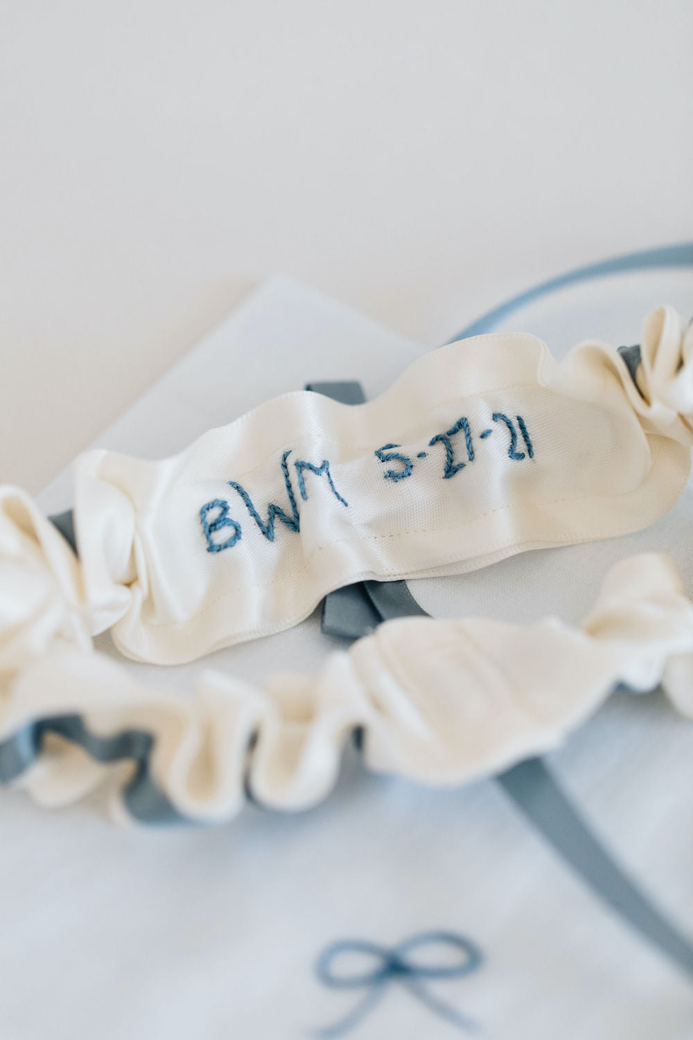 personalized embroidered wedding garter and handkerchief with dusty blue and ivory satin by bridal accessories designer, The Garter Girl