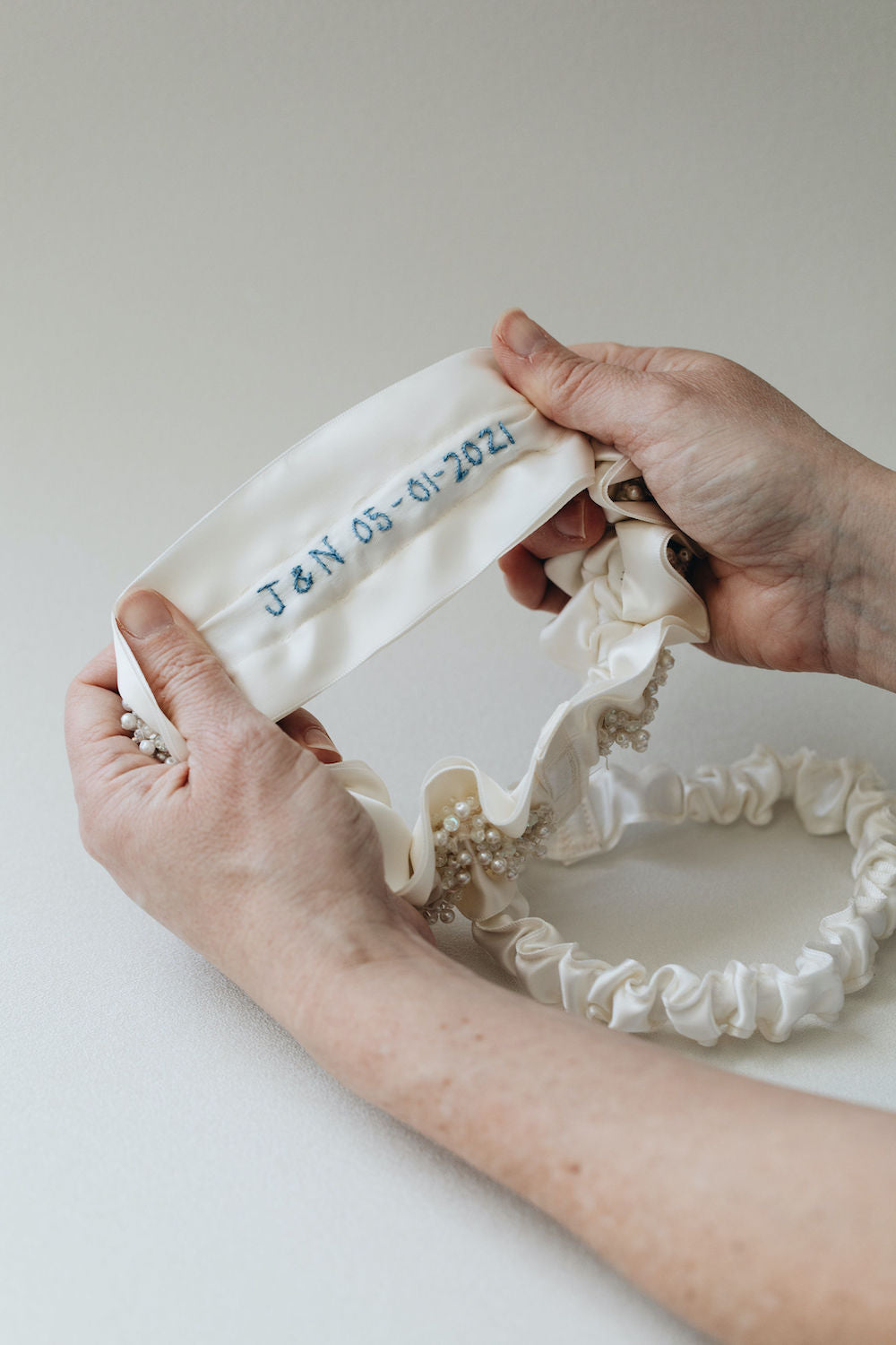 sparkle & satin wedding garter set with personalized something blue embroidery handmade by The Garter Girl