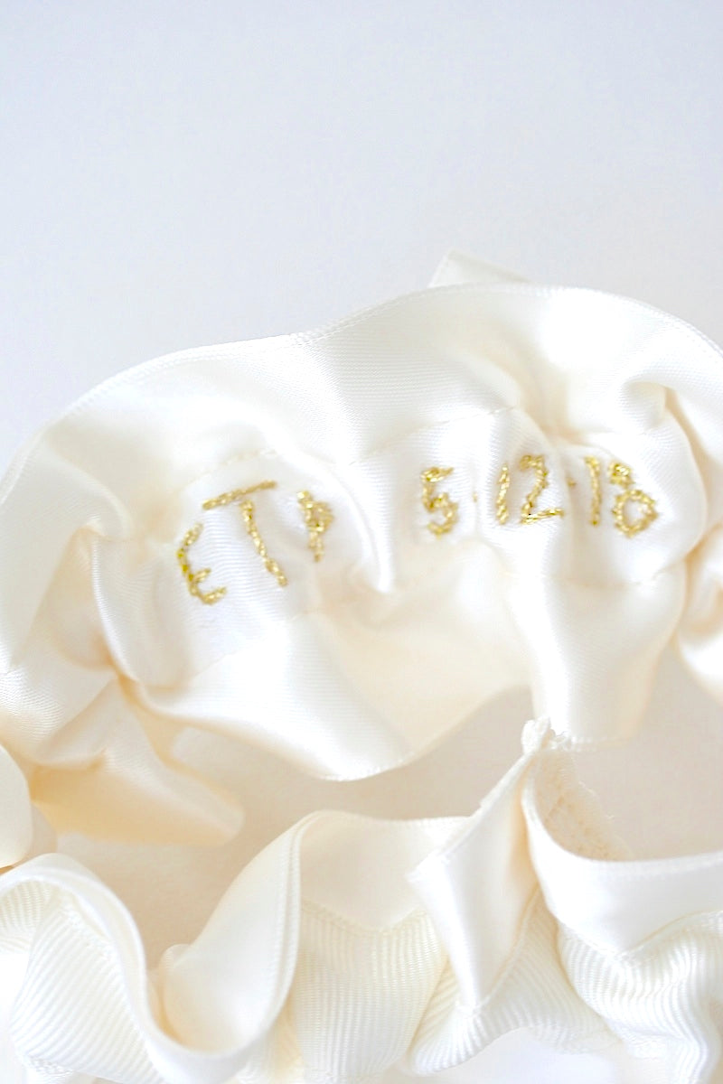 gold embroidery on the inside of custom wedding garter - The Garter Girl