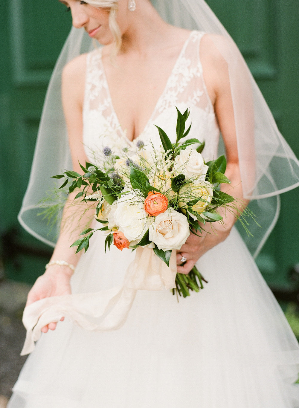 bride w spring bridal bouquet - tips about trying wedding dresses on at home from The Garter Girl