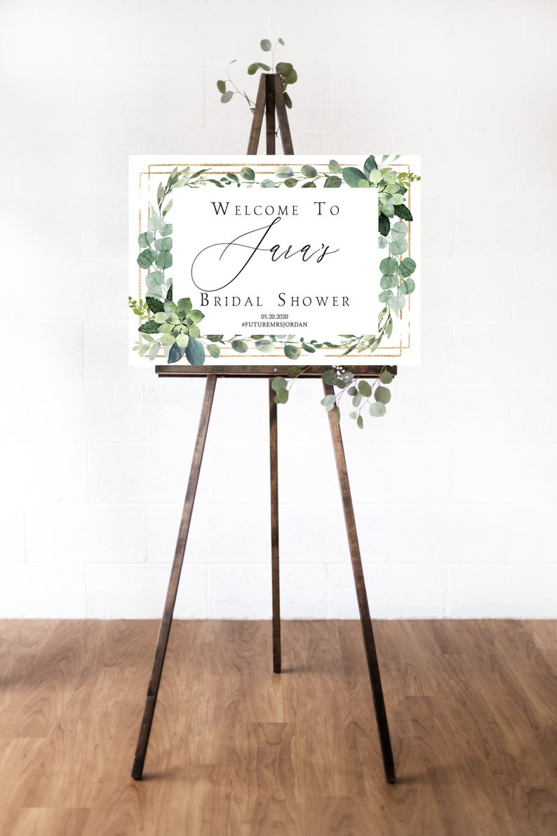 white and floral bridal shower welcome sign