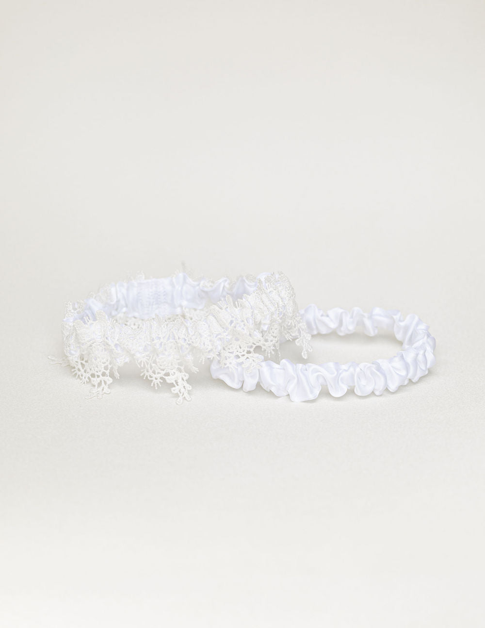 custom wedding garter set with white lace and satin from The Garter Girl