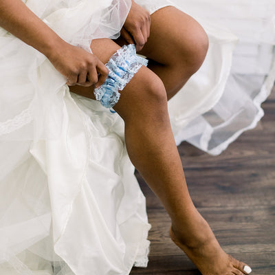 Shop our heirloom blue lace bridal garter for something blue at your wedding.