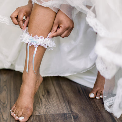Shop our heirloom Mrs. Fancy Pants wedding garter, featuring textured ivory lace.