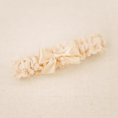 Shop our heirloom champagne satin and lace wedding garter.