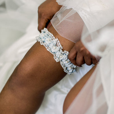 Shop our heirloom lace wedding garter, featuring pearls and vintage style.