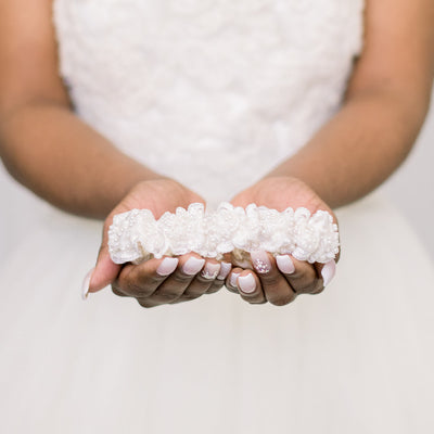 Shop our heirloom ivory satin wedding garter with textured beading.