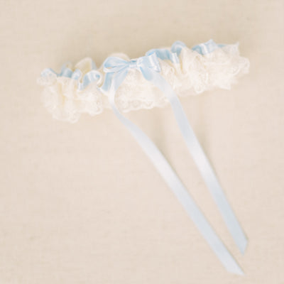 Shop our heirloom ivory and blue wedding garter, featuring lace, ruffles and something blue for your wedding day.