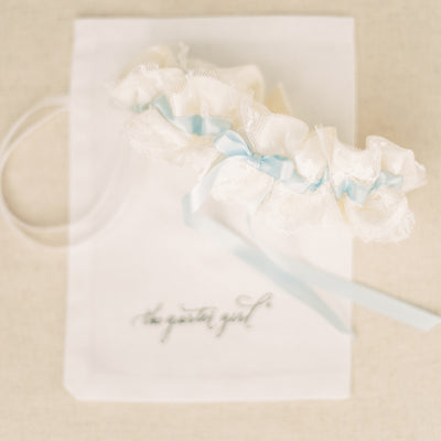 Shop our heirloom wedding garter with blue ribbon, ivory satin and lace made from a vintage wedding dress by The Garter Girl