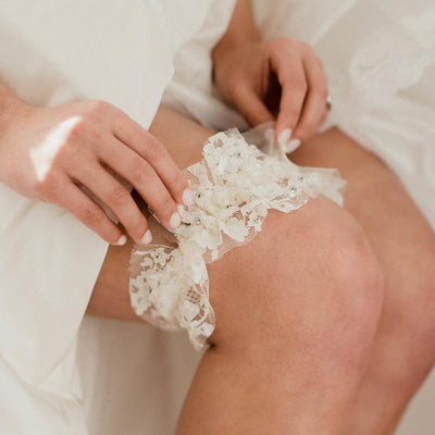 Shop our heirloom sequin and sparkling lace wedding garter that shines bright like a diamond.