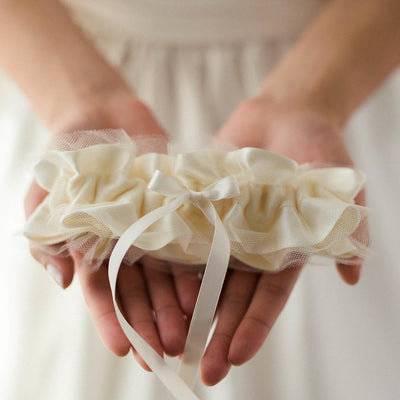Shop our heirloom velvet wedding garter with ivory tulle and satin.
