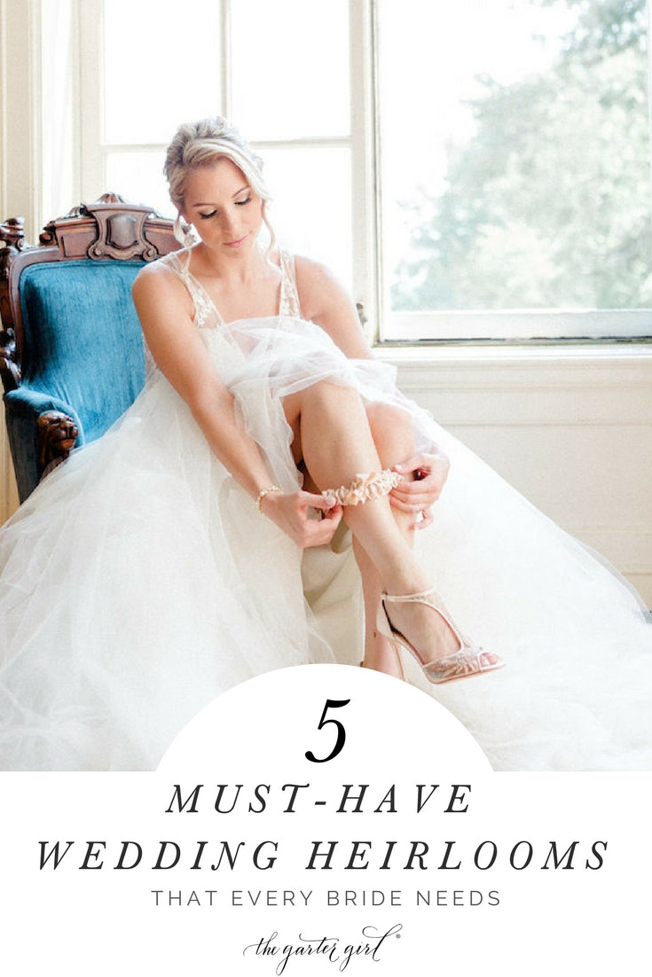 stylish bride putting on wedding garter - the 5 wedding heirlooms every bride needs